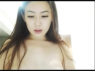 Korean girl fingering shaved pussy on cam