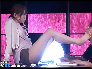 Japanese secretary provokes boss with her feet